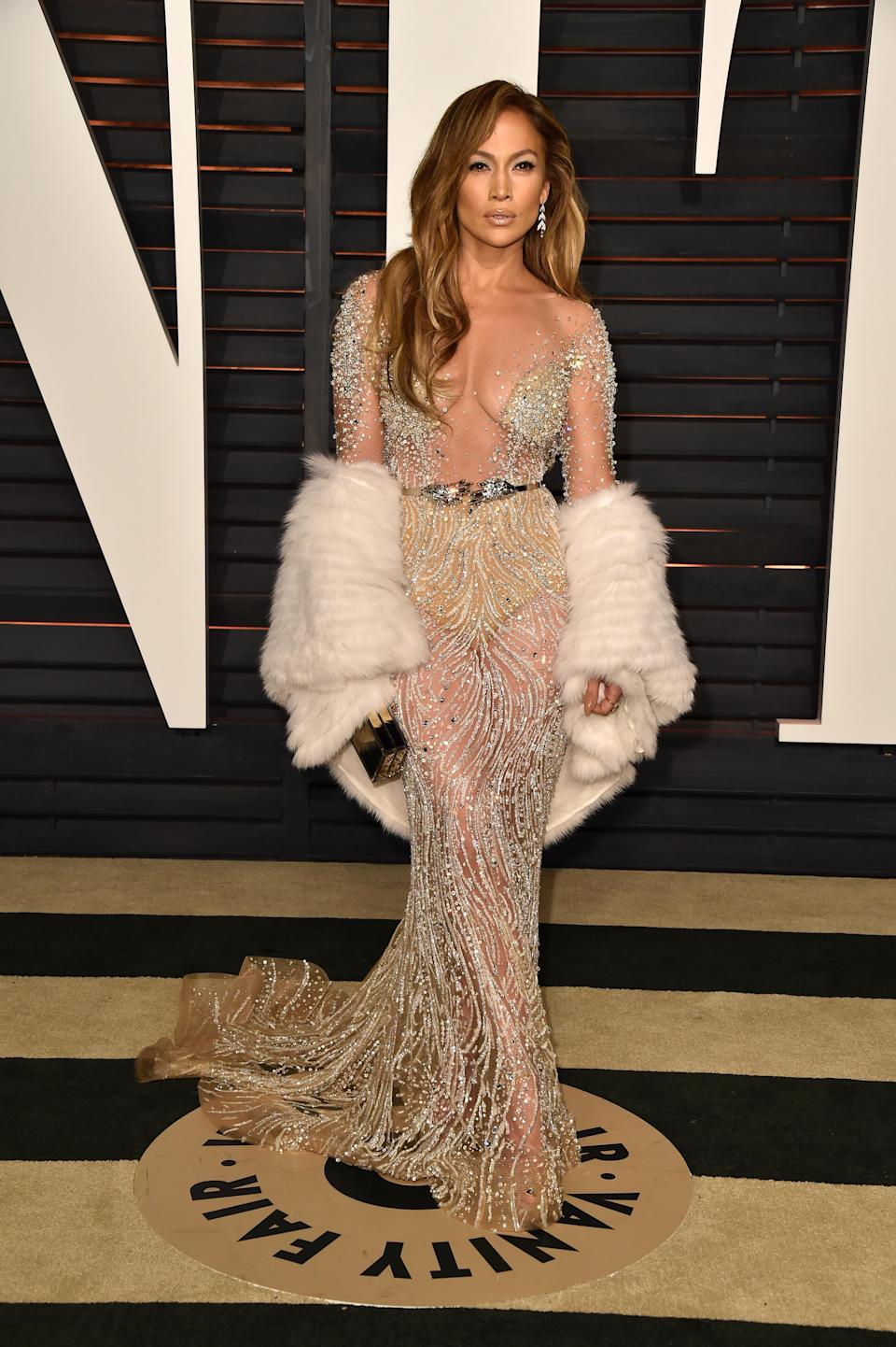 <p>Another sheer piece with a plunging neckline, she made a statement in this belted piece at the Vanity Fair after party. [Photo: Getty] </p>