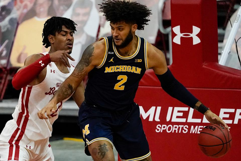 Wisconsin's Aleem Ford defends Michigan's Isaiah Livers during the first half Sunday, Feb. 14, 2021, in Madison, Wis.