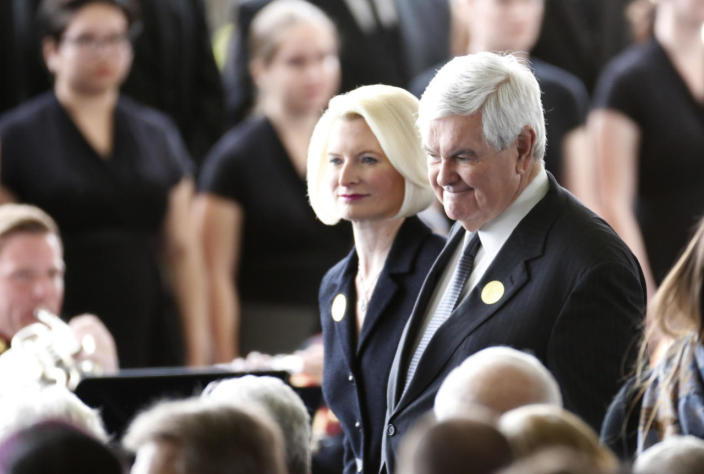 Newt Gingrich and his wife arrive