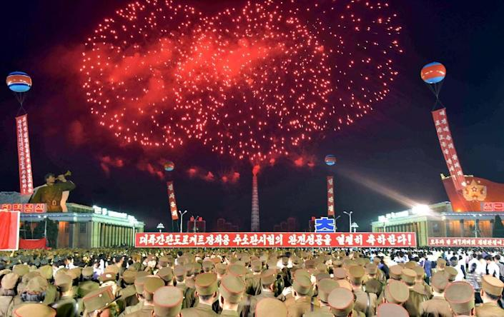 Tens of thousands of people gathered in Kim Il-Sung Square for a mass celebration and fireworks display for scientists involved in North Korea's nuclear test (AFP Photo/STR)