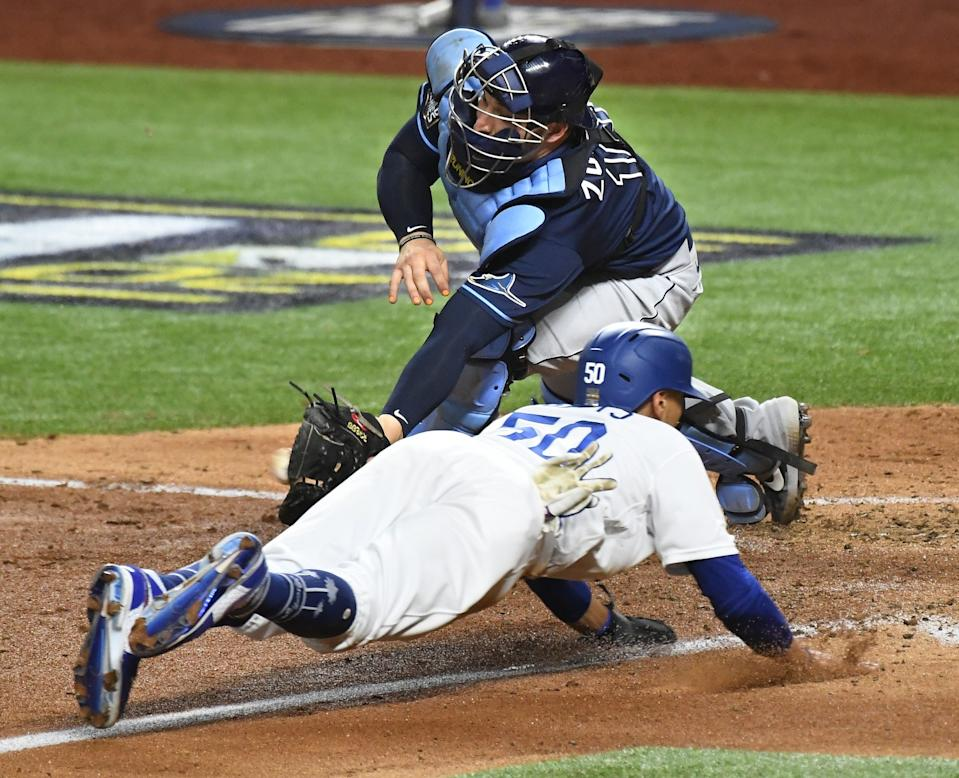 Mookie Betts beats the tag of Rays catcher Mike Zunino to score.
