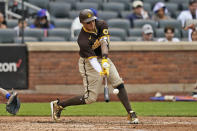 San Diego Padres' Manny Machado hits a solo home run during the seventh inning of a baseball game against the New York Mets at Citi Field, Sunday, June 13, 2021, in New York. (AP Photo/Seth Wenig)