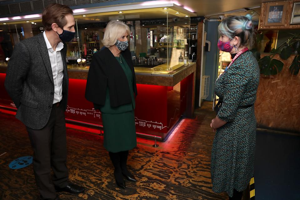 LONDON, ENGLAND - DECEMBER 03: Camilla, Duchess of Cornwall (C) wears a face mask as she speaks to staff during her visit to Soho Theatre with Prince Charles, Prince of Wales to celebrate London's night economy on December 03, 2020 in London, England. (Photo by Chris Jackson - WPA Pool/Getty Images)