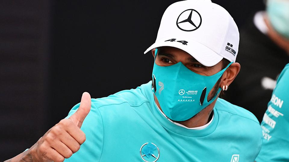 Lewis Hamilton is seen giving a thumbs up after winning the Emilia Romagna Grand Prix.
