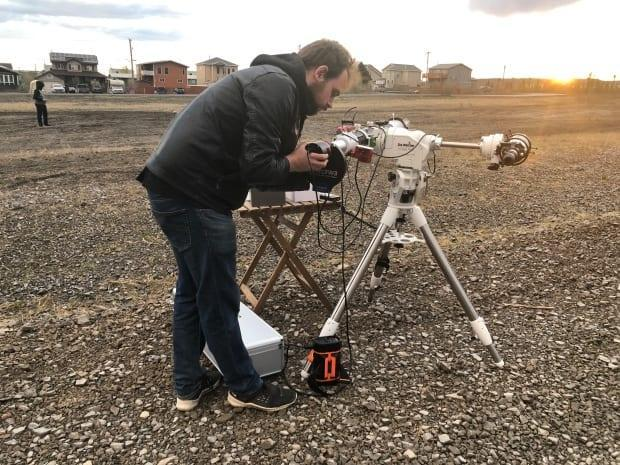 CJ Parr is a high school teacher at East Three Secondary School. He teaches science, physics and math and helped put together a solar eclipse viewing party in Inuvik, N.W.T. (Mackenzie Scott/CBC - image credit)