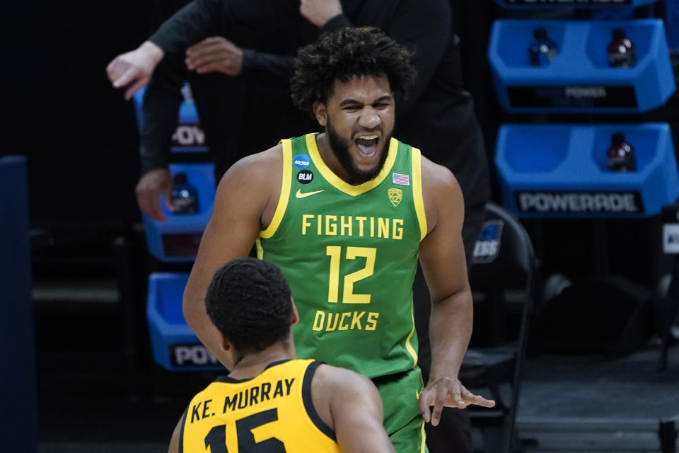 Oregon guard LJ Figueroa (12) reacts to hitting a three-point basket against Iowa during the second half of a men's college basketball game in the second round of the NCAA tournament at Bankers Life Fieldhouse in Indianapolis, Monday, March 22, 2021. (AP Photo/Paul Sancya)