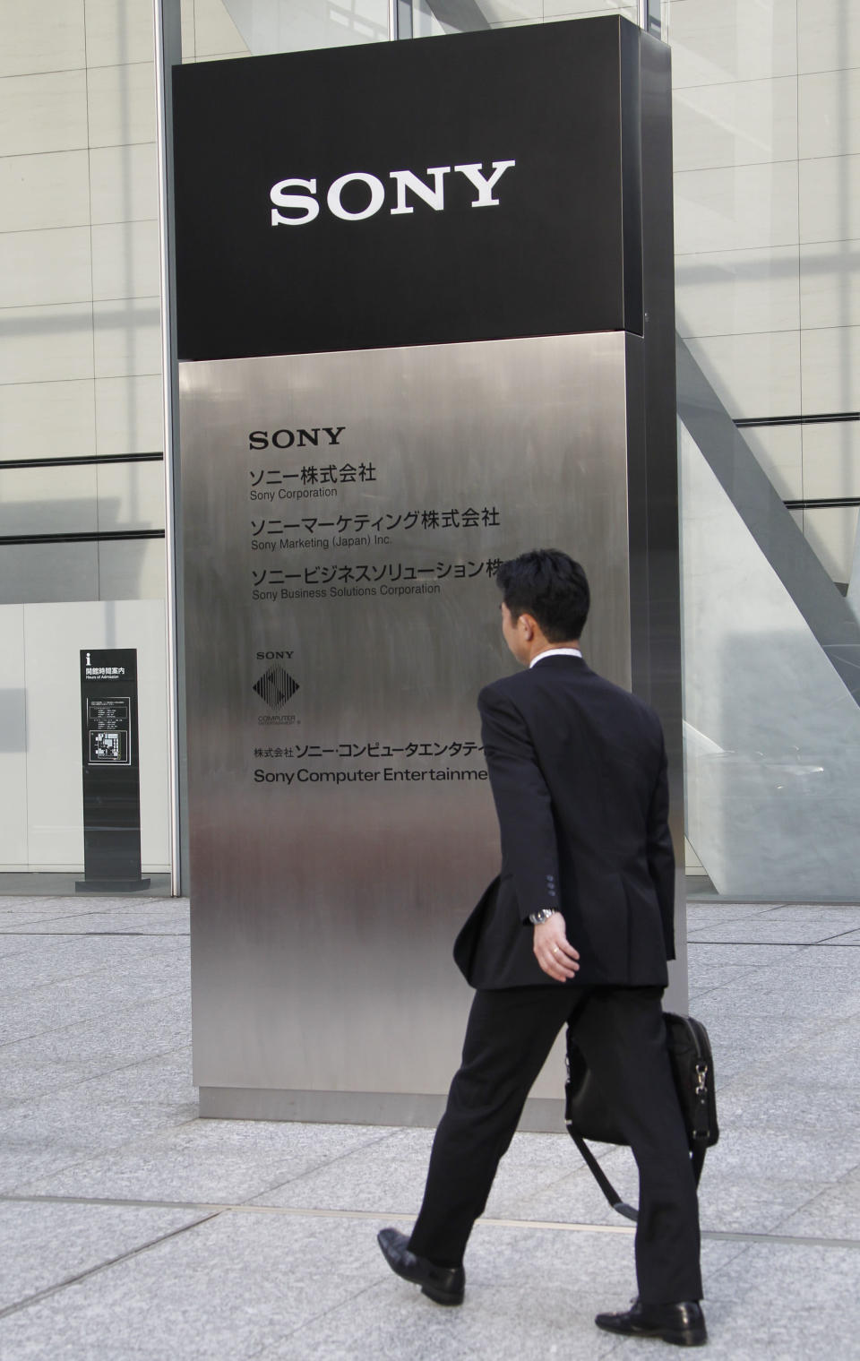 A man walks to the headquarters of Sony Corp. in Tokyo Tuesday, April 10, 2012. Sony more than doubled Tuesday its projected annual loss to 520 billion yen ($6.4 billion), its worst red ink ever, due to a massive tax charge. (AP Photo/Koji Sasahara)