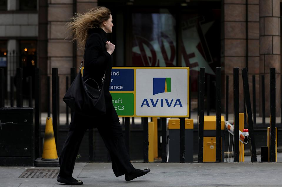 A pedestrians walks past the Aviva logo outside the company head office in the city of London, Britain March 7, 2019. REUTERS/Simon Dawson