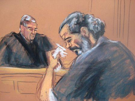 Egyptian Adel Abdul Bary, 54, wipes away tears while facing U.S. District Judge Lewis Kaplan in a Manhattan court in New York on September 19, 2014, in this courtroom sketch.  REUTERS/Jane Rosenberg