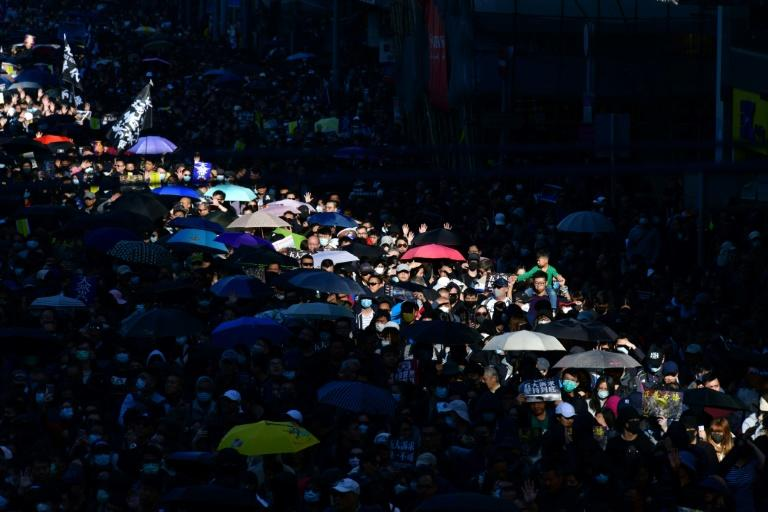 Around 800,000 people marched peacefully through Hong Kong's streets on December 9, urging the government to respond to their five demands (AFP Photo/Anthony WALLACE)