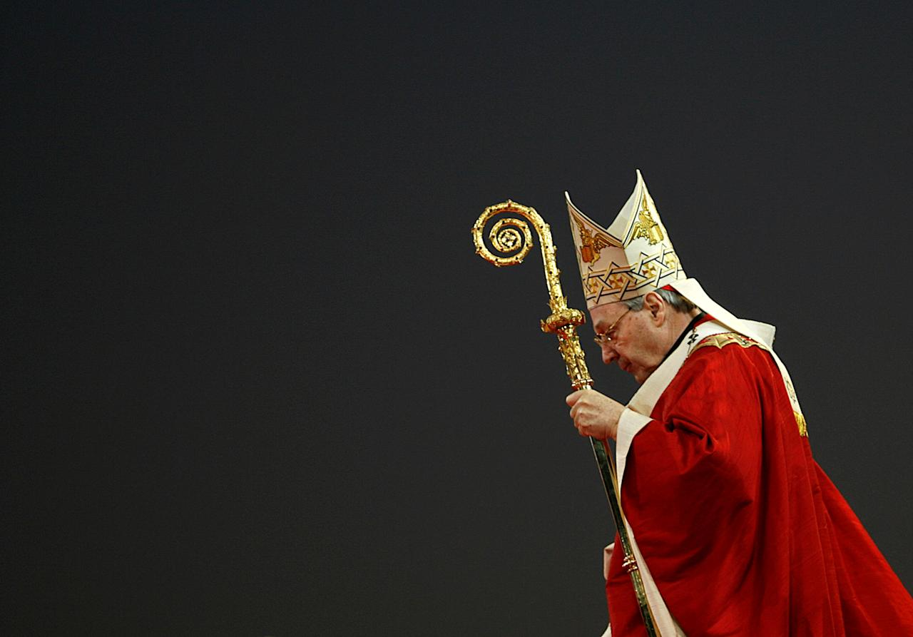 FILE PHOTO - Head of the Catholic Church in Australia Cardinal George Pell leads the World Youth Day opening mass in Sydney July 15, 2008.        REUTERS/Daniel Munoz/File Photo     TPX IMAGES OF THE DAY