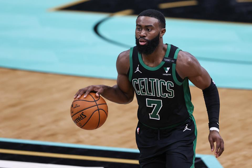 Boston Celtics guard Jaylen Brown (7) brings the ball up court against the Charlotte Hornets in the second half at Spectrum Center. The Charlotte Hornets won 125-104. Mandatory Credit: Nell Redmond-USA TODAY Sports