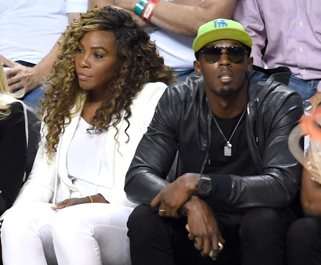 Serena Williams and Usain Bolt watch the Miami Heat and San Antonio Spurs during Game 4 of the 2014 NBA Finals on June 12, 2014 at the American Airlines Arena in Miami, Florida (AFP Photo/Timothy A. Clary)