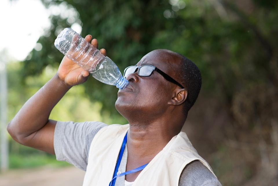 man drinking water after exercising, healthier man after 40