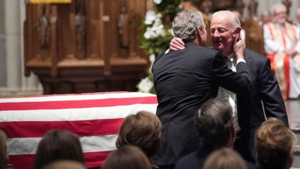 PHOTO: Former President George W. Bush embraces former Secretary of State James Baker, right, after he gave a eulogy during the funeral for former President George H.W. Bush at St. Martin's Episcopal Church, Dec. 6, 2018, in Houston. (David J. Phillip/Pool via AP)