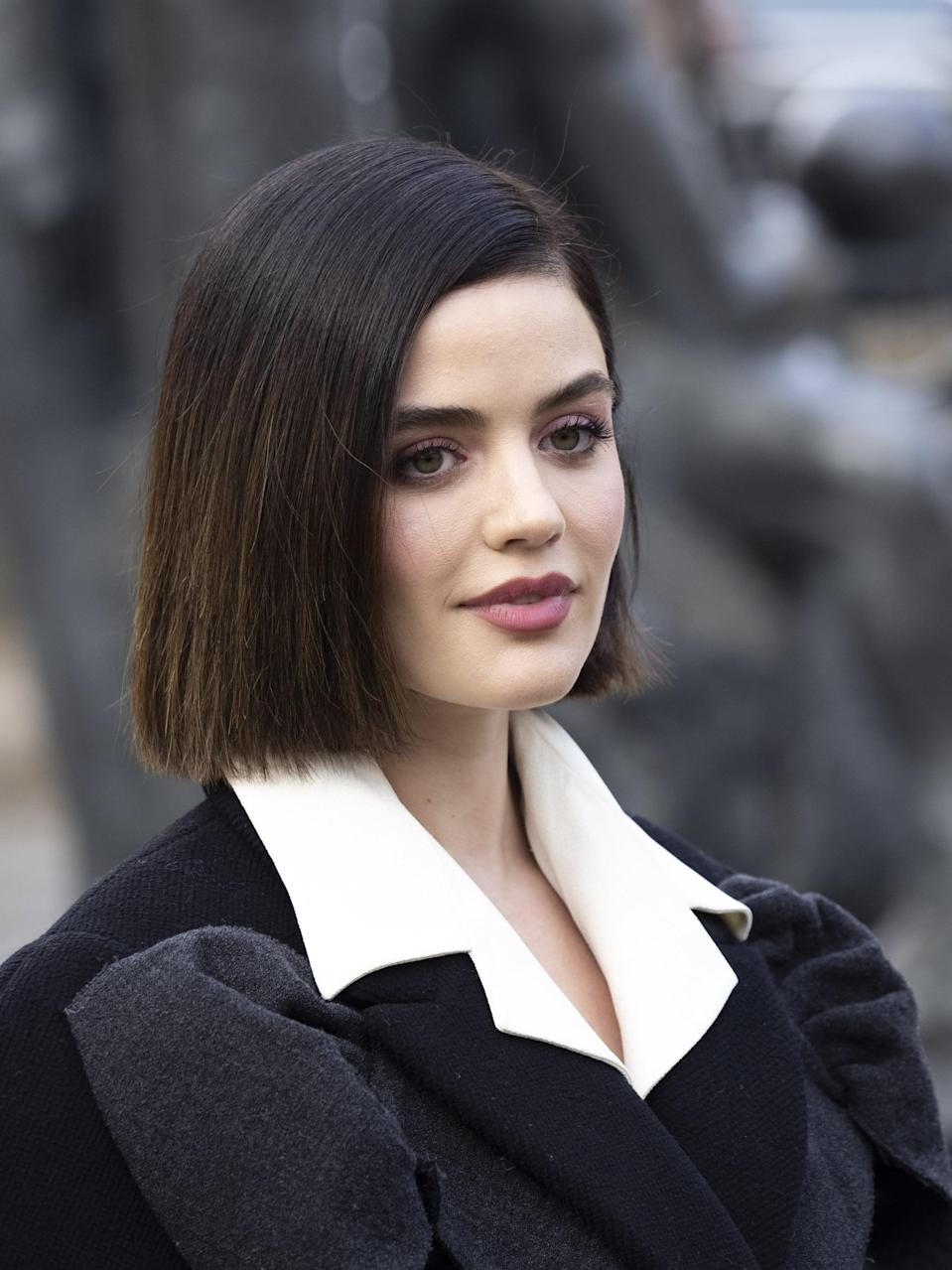 <p>Lucy Hale has had a bob for years, but during Paris Fashion Week in 2020, she styled it with a deep side part. </p>