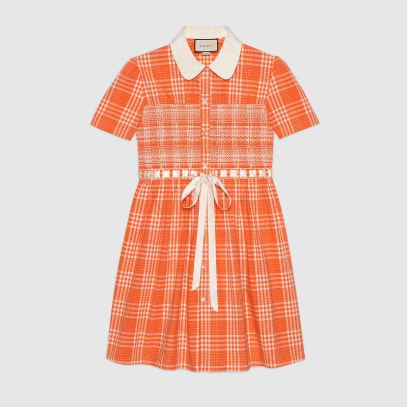 The orange tartan design features a satin bow detail. (Gucci)