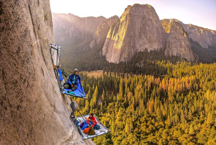Morgane Choquet and Samuel Cobb relax in a vertical campsite on the face of El Capitan, Yosemite National Park, Calif. (Photo: Alexandre Eggermont/Caters News)