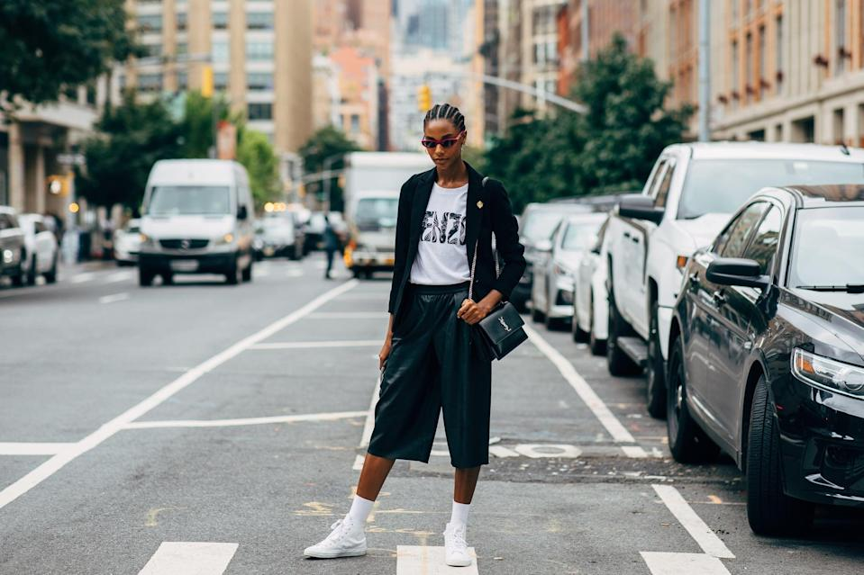 <p>Slip into Bermuda shorts and the sneakers of your choice. </p>