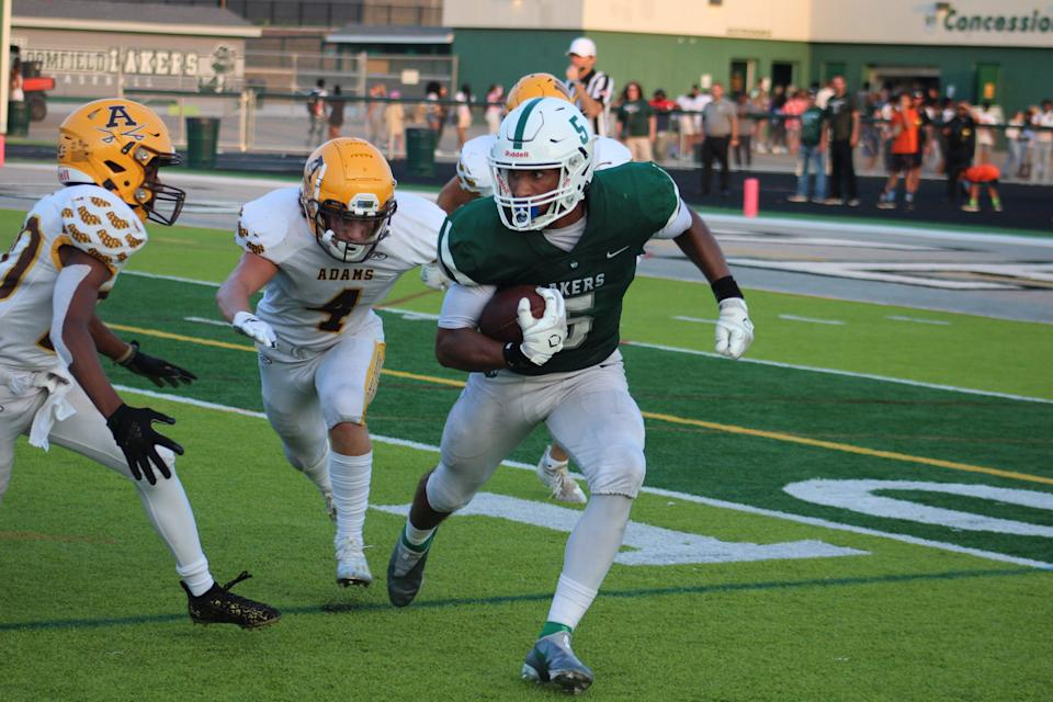 West Bloomfield's Dillon Tatum returns a kickoff in the Lakers' season opener against Rochester Adams on Aug. 27, 2021. Tatum, a running back, is being recruited as a defensive back, but really gets a rush from kick returns.