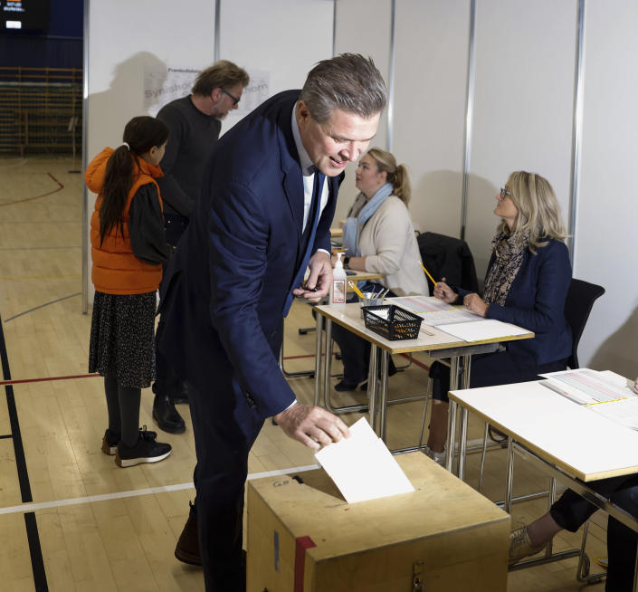 Independent Party candidate Bjarni Benediktsson casts his ballot at a polling station, in Gardabae, Iceland, Saturday, Sept. 25, 2021. Icelanders are voting in a general election dominated by climate change, with an unprecedented number of political parties likely to win parliamentary seats. Polls suggest there won't be an outright winner on Saturday, triggering complex negotiations to build a coalition government. (AP Photo/Brynjar Gunnarsson)