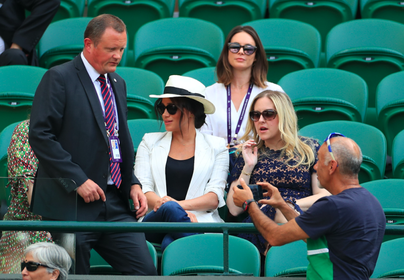 The Duchess of Sussex's protection officer told another fan she was at the tennis tournament in a 'private capacity' (PA)
