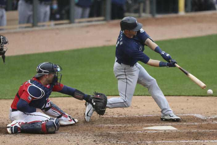 Seattle Mariners' Mitch Haniger (17) strikes out swinging during the eighth inning of a baseball game against the Minnesota Twins, Saturday, April 10, 2021, in Minneapolis. Seattle won 4-3 in the 10 inning. (AP Photo/Stacy Bengs)