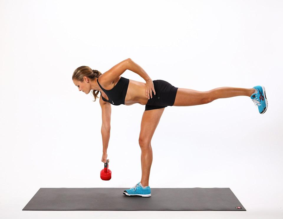 """<p>""""By focusing on one side and going heavy, you can feel your glutes on the standing leg right away,"""" said <a href=""""https://www.instagram.com/taralaferrara/"""" class=""""link rapid-noclick-resp"""" rel=""""nofollow noopener"""" target=""""_blank"""" data-ylk=""""slk:Tara Laferrara"""">Tara Laferrara</a>, a NASM-certified trainer who's kettlebell-certified through Onnit Academy. """"If you pick your opposite foot and draw your heel up towards the sky, you can get a little glute activation on that leg as well.""""</p> <ul> <li>Hold a kettlebell in your right hand, and lift your left foot slightly off the ground.</li> <li>Keeping your back neutral, lean your entire torso forward while raising your left leg, which should stay in line with your body. The kettlebell will lower toward the ground. Keep your left shoulder blade pulled down your back.</li> <li>With your back straight, return upright, coming to your starting position.</li> <li>This completes one rep. Maximize this move by keeping your right foot off the ground as you go through your reps.</li> </ul>"""
