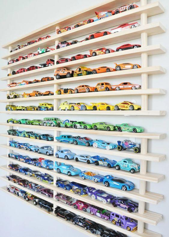 """<p>Never again will you have to answer the age old question, """"Mom, where's my car?"""" thanks to this simple shelf that serves as a garage for toy cars.</p><p><a class=""""link rapid-noclick-resp"""" href=""""https://go.redirectingat.com?id=74968X1596630&url=https%3A%2F%2Fwww.etsy.com%2Flisting%2F781349770%2Ftoy-car-storage-hot-wheels-toy-car&sref=https%3A%2F%2Fwww.redbookmag.com%2Fhome%2Fg36014277%2Ftoy-organizer-ideas%2F"""" rel=""""nofollow noopener"""" target=""""_blank"""" data-ylk=""""slk:SHOP TOY CAR GARAGES"""">SHOP TOY CAR GARAGES</a></p>"""