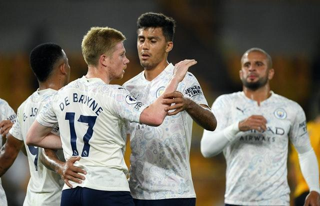 De Bruyne (left) scored a penalty as City won 3-1 at Wolves