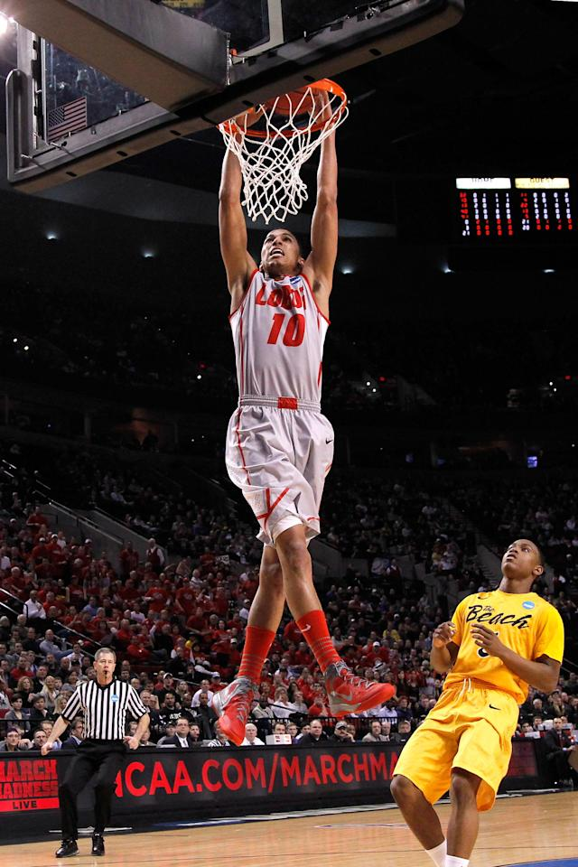 PORTLAND, OR - MARCH 15: Kendall Williams #10 of the New Mexico Lobos dunks the ball in the first half while taking on the Long Beach State 49ers in the second round of the 2012 NCAA men's basketball tournament at Rose Garden Arena on March 15, 2012 in Portland, Oregon. (Photo by Jonathan Ferrey/Getty Images)