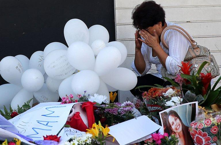 A relative of a victim weeps in front of the Kiss nightclub in Santa Maria, southern Brazil, on January 29, 2013