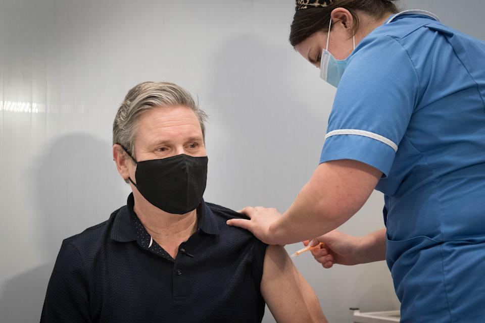 Labour leader Sir Keir Starmer receives his first dose of the Astra Zeneca coronavirus vaccine from midwife, Emily Malden at the Francis Crick Institute in his Holborn and St Pancras constituency. Picture date: Sunday March 14, 2021. (Photo by Stefan Rousseau/PA Images via Getty Images)