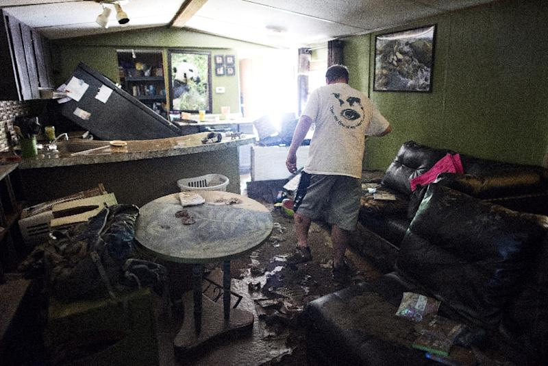 Larry Brooks walks through his trailer which was destroyed by flood waters in Elkview, West Virginia (AFP Photo/Ty Wright)