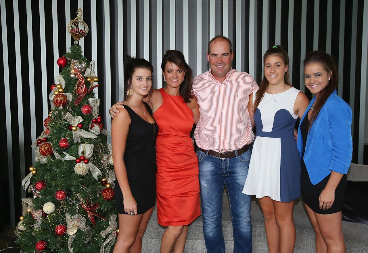 MELBOURNE, AUSTRALIA - DECEMBER 25:  Australian coach Mickey Arthur (C) poses with his family (L to R) Brooke, wife Yvette, Ashton and Kristin next to a Christmas tree ahead of a Cricket Australia Christmas Day lunch at Crown Entertainment Complex on December 25, 2012 in Melbourne, Australia.  (Photo by Scott Barbour/Getty Images)
