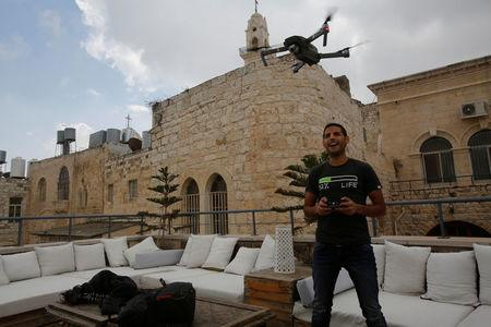 Nuseir Yassin flies his drone in the old city of the West Bank city of Bethlehem
