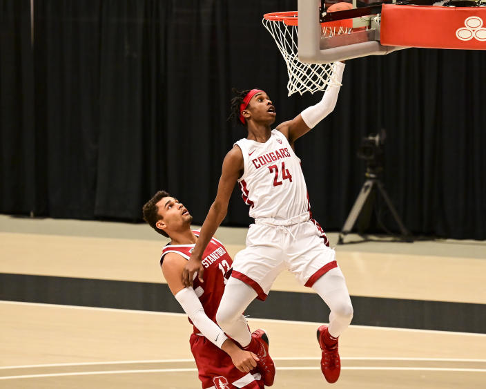 Washington State guard Noah Williams (24) attempts a layup next to Stanford forward Oscar da Silva (13) during the first half of an NCAA college basketball game, Saturday, Feb. 20, 2021, in Pullman, Wash. (AP Photo/Pete Caster)
