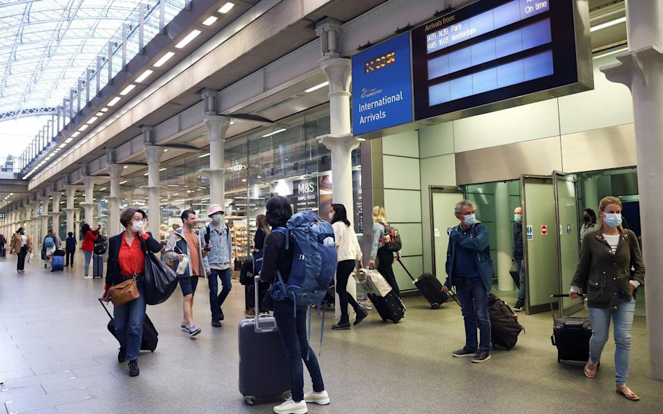Travellers exit from an arrivals gate at St Pancras International station following the arrival of a Eurostar train from Paris - Henry Nicholls/Reuters
