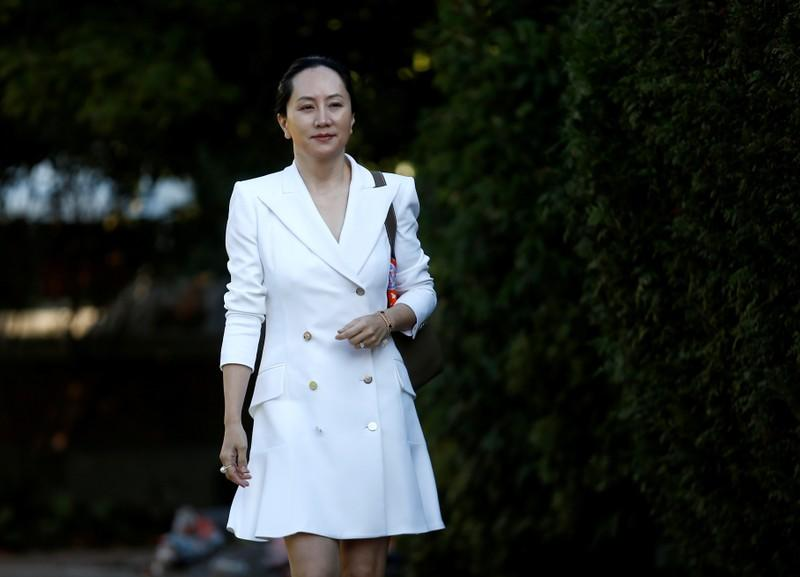 FILE PHOTO: Huawei Technologies Chief Financial Officer Meng Wanzhou leaves her home to appear in British Columbia supreme court in Vancouver