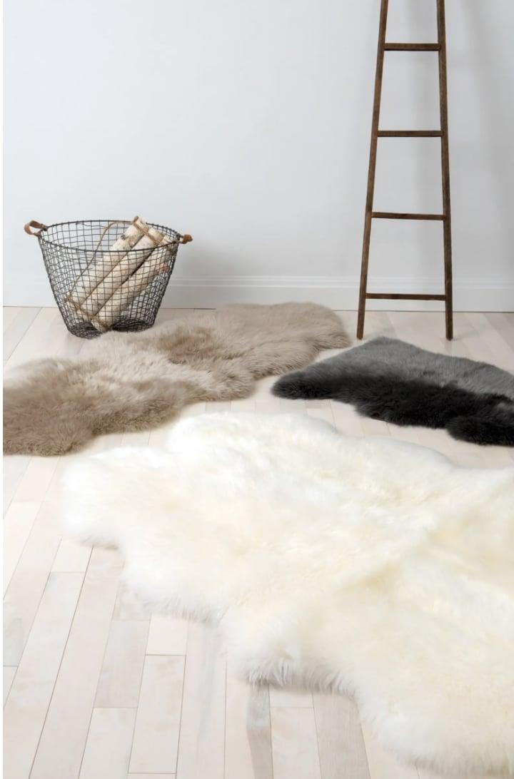<p>You'll feel like you're walking on a cloud when your feet touch this ultraplush <span>Genuine Sheepskin Rug</span> ($145-$495).</p>