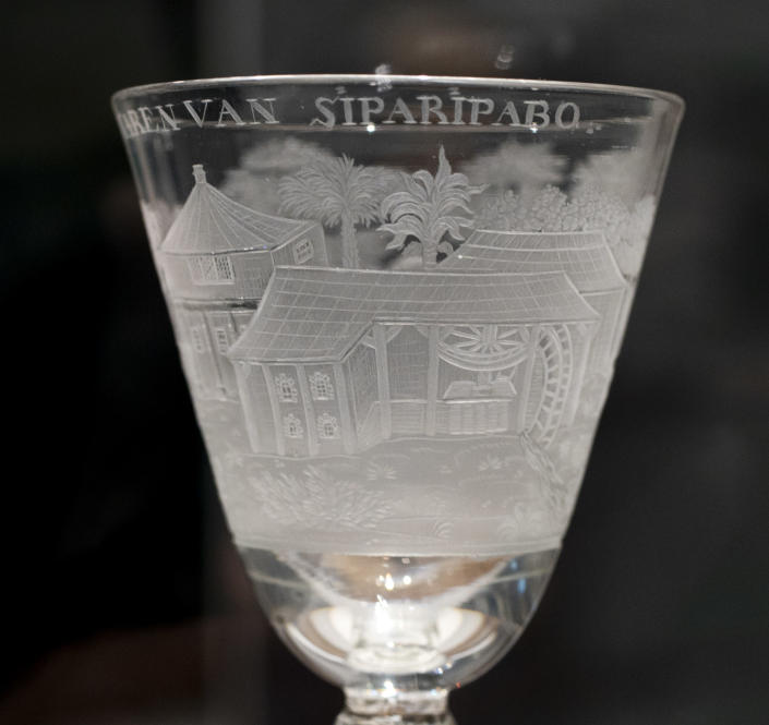 """A ceremonial glass commissioned by plantation owners is seen at the Slavery exhibition at the Rijksmuseum in Amsterdam, Netherlands, Monday, May 17, 2021. The stark contrast between finery and brutality, wealth and inhumanity is a recurring pattern at the museum's unflinching new exhibition titled, simply, """"Slavery"""", that examines the history of Dutch involvement in the international slave trade. (AP Photo/Peter Dejong)"""