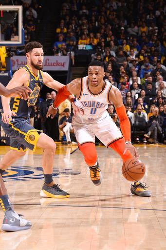 OAKLAND, CA - NOVEMBER 21: Russell Westbrook #0 of the Oklahoma City Thunder handles the ball during the game against the Golden State Warriors on November 21, 2018 at ORACLE Arena in Oakland, California. (Photo by Noah Graham/NBAE via Getty Images)