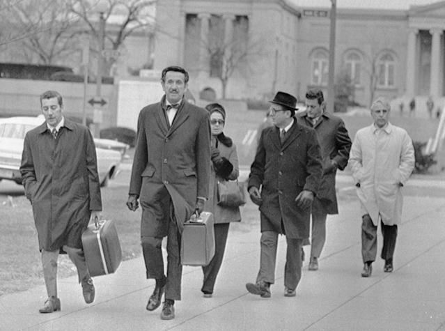 "<p>The trial of the ""Watergate Seven,"" the men accused of bugging the headquarters of the Democratic National Committee in June, 1972, opened in Washington, D.C., on Jan 8, 1973. Shown arriving, left to right, are: Virgilio Gonzales; Henry Rothblatt, attorney; Bernard Baker; Frank Sturgis; and Eugenio Martinez. The woman is unidentified. (Photo: Bettmann/Getty Images) </p>"