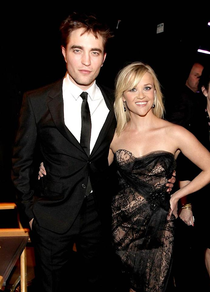 "While Britney was getting jungle fever, Robert Pattinson and Reese Witherspoon were across town at the 46th Annual Academy of Country Music Awards. In her first public appearance since her wedding last weekend, Reese presented the award for Favorite Female Vocalist with her ""Water For Elephants"" co-star, and in a humorous on-stage exchange, the Tennessee native taught English Rob how to say ""Hey all y'all"" like a true Southerner. Christopher Polk/ACMA2011/<a href=""http://www.gettyimages.com/"" target=""new"">GettyImages.com</a> - April 3, 2011"