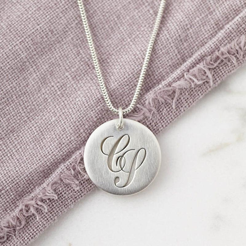 """<a href=""""https://fave.co/2OMfBnr"""">Sterling Silver Initial Monogram Necklace engraved with a hidden Secret Message on the reverse, Sally Clay, Etsy, </a>&pound;69 (Photo: Huffington Post UK )"""