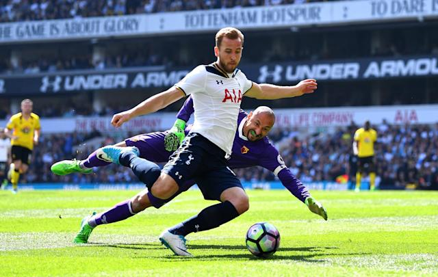 <p>Harry Kane takes the ball past Watford keeper Heurelho Gomes</p>