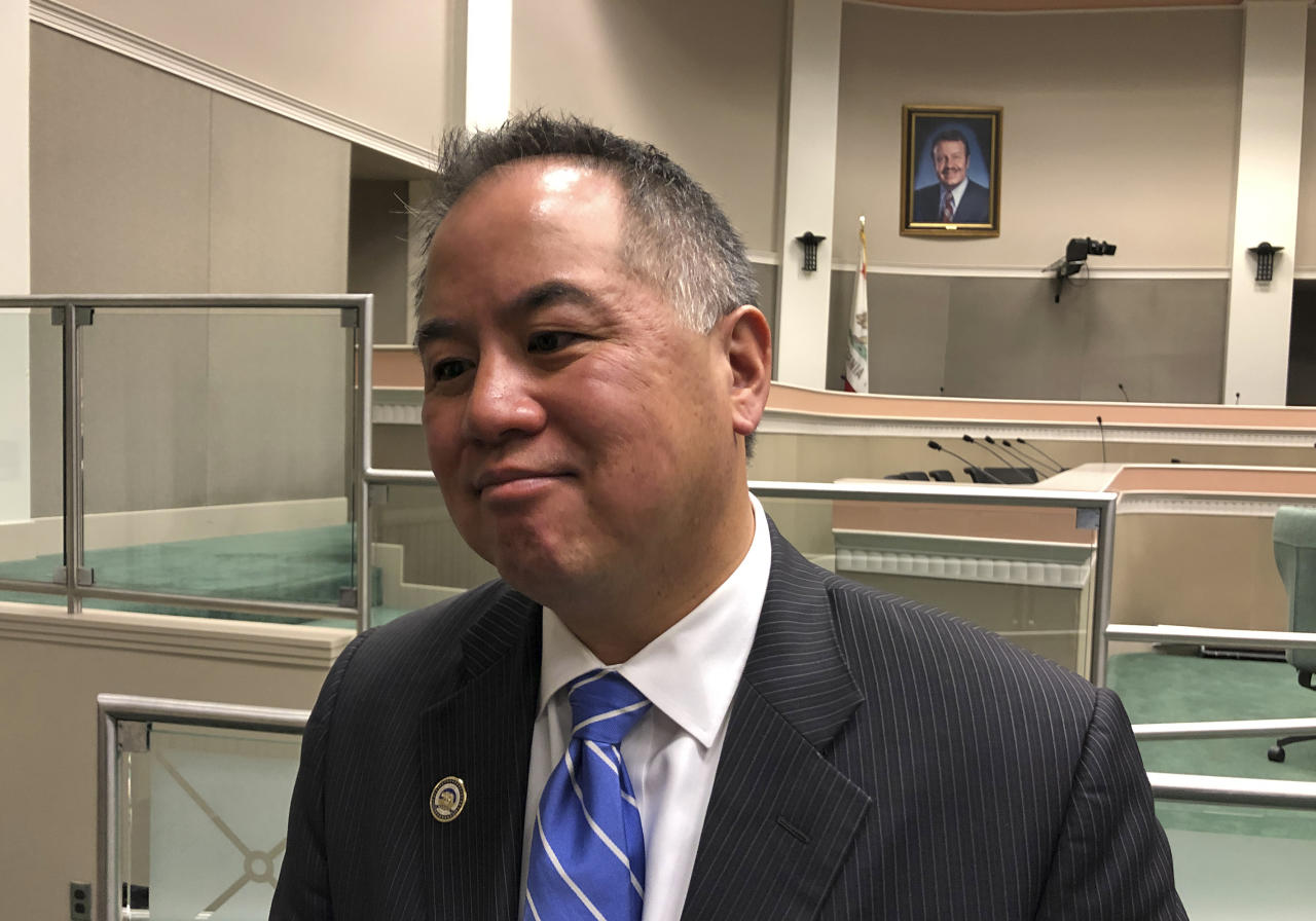 California state Assembly Budget Committee chairman Phil Ting, D-San Francisco, speaks with reporters at the state Capitol on Friday, May 24, 2019, in Sacramento, Calif. The Assembly Budget Committee finalized its spending plan on Friday. Lawmakers are headed toward a confrontation with Gov. Gavin Newsom about whether to continue a tax that helps pay for low-income health care benefits. (AP Photo/Adam Beam)