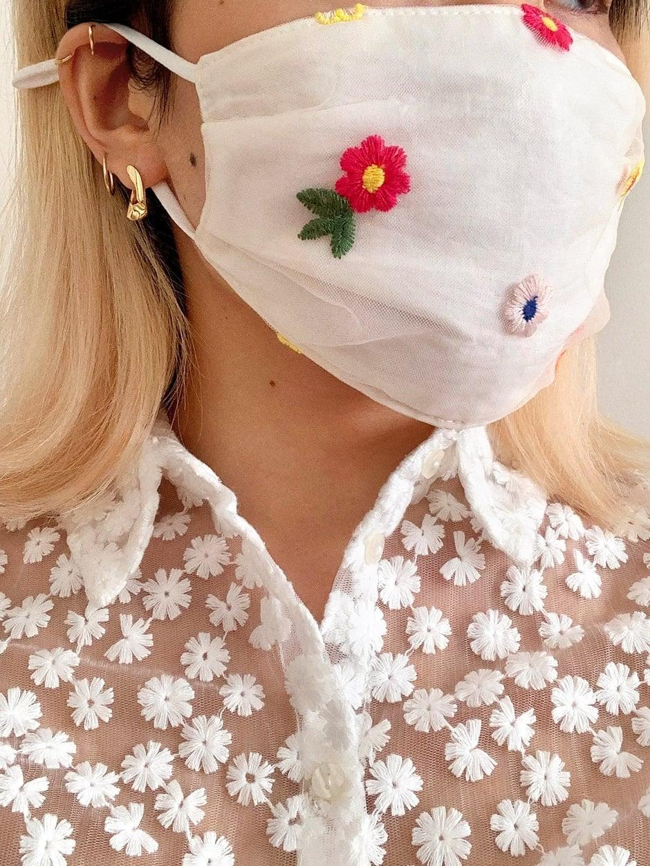 """<p>These <a href=""""https://www.popsugar.com/buy/BaubleBar-Face-Masks-587123?p_name=BaubleBar%20Face%20Masks&retailer=baublebar.com&pid=587123&price=12&evar1=fab%3Aus&evar9=47606849&evar98=https%3A%2F%2Fwww.popsugar.com%2Ffashion%2Fphoto-gallery%2F47606849%2Fimage%2F47606963%2FBaubleBar-Face-Masks&list1=shopping%2Ceditors%20pick%2Csummer%20fashion%2Cfashion%20shopping&prop13=mobile&pdata=1"""" class=""""link rapid-noclick-resp"""" rel=""""nofollow noopener"""" target=""""_blank"""" data-ylk=""""slk:BaubleBar Face Masks"""">BaubleBar Face Masks</a> ($12, set of two) are on preorder, but I'm definitely adding them to my cart. This flower one in particular is pretty.</p>"""