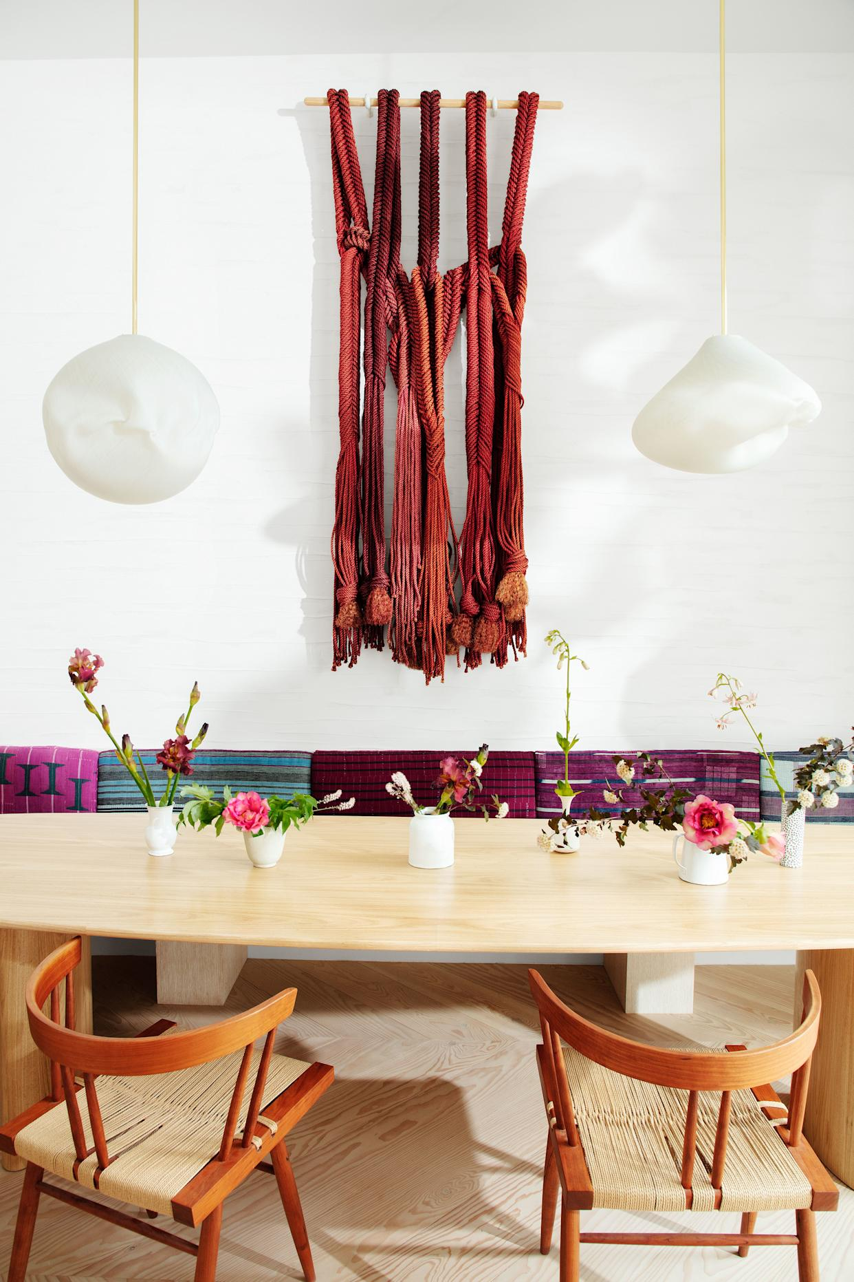 """<div class=""""caption""""> A textile work by Françoise Grossen is displayed in the dining area. </div>"""