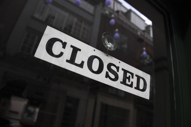A closed sign is displayed in the door of a restaurant as the lockdown due to the coronavirus outbreak continues, in London, Thursday, April 30, 2020.(AP Photo/Alberto Pezzali)